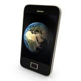 La terre de planète sur le smartphone Image libre de droits