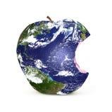 La terre de planète sur une pomme Photographie stock