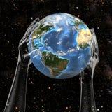 La terre de prise de mains dans l'espace illustration stock