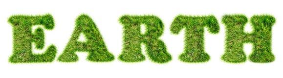 La terre de Word écrite avec l'herbe verte Photographie stock libre de droits
