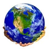 La terre sur des mains Images libres de droits