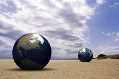 La terre sur une plage Photos stock