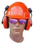 La testa del modello è in un casco di configurazione Fotografia Stock