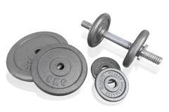La testa di legno ed i pesi dell'argento dell'attrezzatura di esercizio di forma fisica placcano l'iso Immagini Stock