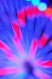 La textura de la falta de definición de la rueda colorida del transbordador del carnaval se enciende Imagen de archivo