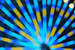 La textura de la falta de definición de la rueda colorida del transbordador del carnaval se enciende Fotos de archivo libres de regalías