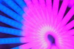 La textura de la falta de definición de la rueda colorida del transbordador del carnaval se enciende Foto de archivo libre de regalías