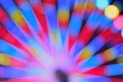La textura de la falta de definición de la rueda colorida del transbordador del carnaval se enciende Fotografía de archivo libre de regalías