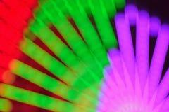 La textura de la falta de definición de la rueda colorida del transbordador del carnaval se enciende Foto de archivo