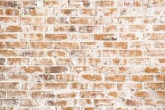 La textura de la pared de ladrillo vieja, blanca y roja Foto de archivo