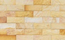 La textura de la pared de piedra de la arena y el ackground de adornan fotografía de archivo