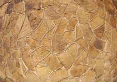 La textura de la pared de piedra marrón Foto de archivo libre de regalías