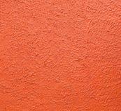 La textura de la pared del color anaranjado cerca pintado para el fondo Fotografía de archivo libre de regalías