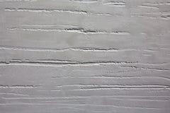 La textura de la piedra es blanca grisácea con irregularidades Foto de archivo