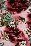 La textura de la tela de la impresión rayó el leopardo y la flor Imagen de archivo