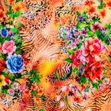 La textura de la tela de la impresión rayó el leopardo y la flor Foto de archivo libre de regalías