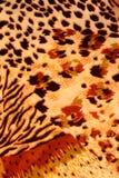 La textura de la tela de la impresión rayó el leopardo y la flor para el backgroun Foto de archivo libre de regalías