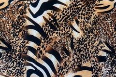 La textura de la tela de la impresión rayó la cebra y el leopardo Foto de archivo libre de regalías