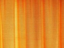 La textura de mirada de oro de la cortina para el fondo de cualquier contenido se opone Fotografía de archivo