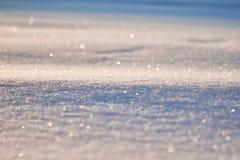 La textura de la nieve brilla en modelo del sol La Navidad, Año Nuevo, mañana antes del día de fiesta La Navidad Fotos de archivo libres de regalías