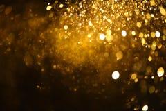 La textura de oro Colorfull del brillo empañó el fondo abstracto para el cumpleaños, el aniversario, la boda, la Noche Vieja o la imagen de archivo
