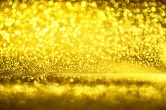 La textura de oro Colorfull del brillo empañó el fondo abstracto para el cumpleaños, el aniversario, la boda, la Noche Vieja o la imagen de archivo libre de regalías