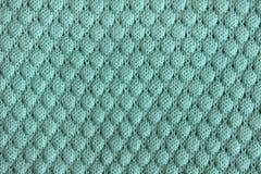 La textura de punto de lanas azules hizo punto la tela con el modelo fotografía de archivo