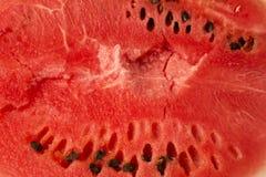 La textura de la sandía madura, roja con las semillas Primer Fotos de archivo