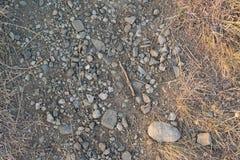 La textura de la tierra con las piedras Imágenes de archivo libres de regalías