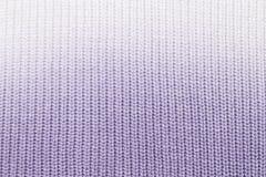 La textura de un azul hecho punto de la tela de lana foto de archivo