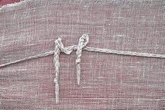 La textura de una harpillera cubierta con un nudo de la cuerda imagen de archivo