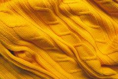 La textura de una tela de lana hecha punto Fondo para crear las disposiciones de un invierno, tarjetas de Navidad, banderas Suéte Foto de archivo