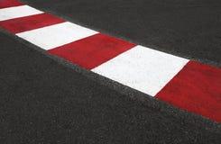 La textura del asfalto de la raza y el encintado Grand Prix circulan Imágenes de archivo libres de regalías