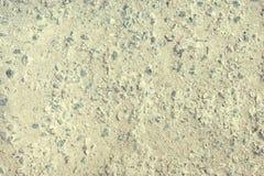 La textura del asfalto gastado, grava se considera Viejo fondo vacío de la superficie de la carretera Foto de archivo libre de regalías