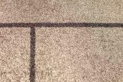 La textura del beige lanoso suave de la alfombra, el concepto de comodidad fotos de archivo