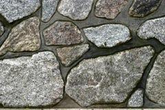 La textura del fondo es una pared de piedra del granito imagenes de archivo