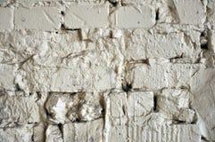 La textura resistida extracto manch? el estuco viejo gris claro y envejeci? el fondo blanco de la pared de ladrillo de la pintura imagen de archivo
