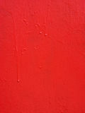 La textura roja del metal con una aspereza y los descensos de la pintura emergen Fondo urbano de Grunge fotos de archivo libres de regalías