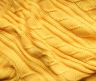 La textura, superficie de una tela de lana hecha punto Fondo, contexto para crear las disposiciones de un invierno, tarjetas de N Fotos de archivo libres de regalías