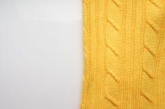 La textura, superficie de una tela de lana hecha punto Fondo, contexto para crear las disposiciones de un invierno, tarjetas de N Imágenes de archivo libres de regalías