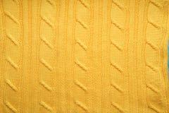 La textura, superficie de una tela de lana hecha punto Fondo, contexto para crear las disposiciones de un invierno, tarjetas de N Fotografía de archivo libre de regalías