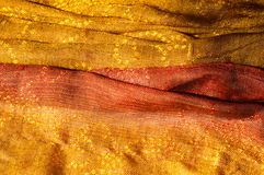 La texture d'or rouge de jaune de tissu de laine photo stock