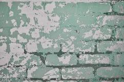 La texture d'un mur de briques très vieux avec un épluchage et une Co rugueuse Photos libres de droits