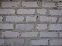 La texture de brique avec des fissures et des éraflures photos stock