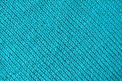 La texture de l'alpaga coloré de bleu de turquoise a tricoté le tissu de laine dans les modèles diagonaux images stock