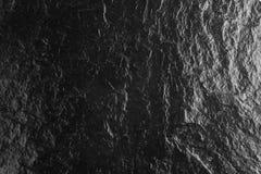 La texture de pierre de dessus de table et le fond noirs, surface de lustre photos stock