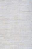 La texture de toile de fibre blanche lumineuse naturelle de lin a détaillé le modèle chiffonné rustique de toile de toile de jute Photographie stock libre de droits