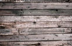 La texture de la vieille barrière en bois avec coupés les noeuds et les fissures Papier peint pour la conception de cru photo libre de droits