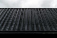 La texture du conteneur métallique marin est noire Plan rapproché Transport des cargaisons de mer photo stock