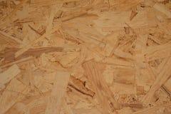 La texture du plat d'OSB est faite à partir des copeaux en bois et de la sciure, morceaux de bois Fond sans couture uniforme photos libres de droits